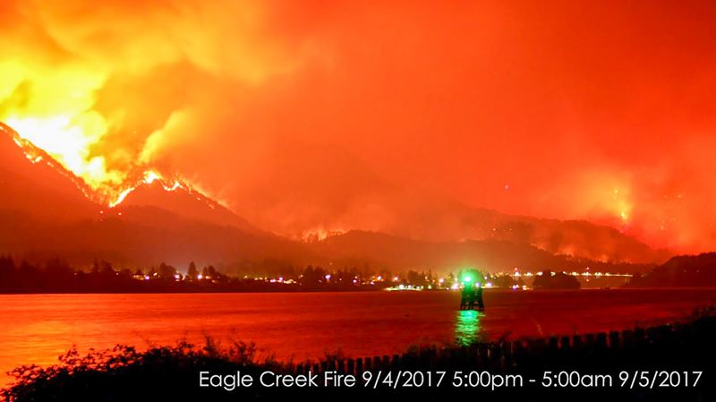 COURTESY PHOTO - The Eagle Creek Fire lights up the night sky on Monday, Sept. 4. This view is taken from the Washington side of the Columbia River, with the lights of Cascade Locks and the Bridge of the Gods shown on the Oregon side of the river.