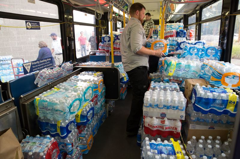 HANDOUT PHOTO - Volunteers pack supplies onto a TriMet bus during the Eagle Creek wildfire.