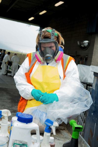 COURTESY OF METRO  - Workers wear protective gear to handle potentially hazardous materials at the dropff center.