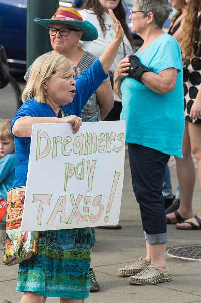 NEWS-TIMES PHOTO: CHRISTOPHER OERTELL - Forest Grove resident Kristinoel Ludwig makes a point with her sign.