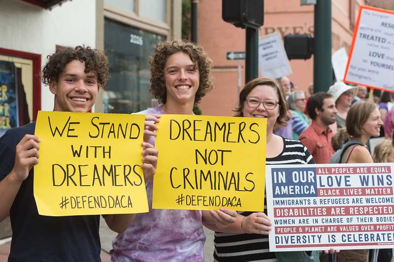 NEWS-TIMES PHOTO: CHRISTOPHER OERTELL - James Irvine, 15, from Cornelius, joins Eli Leto, 14, and Krissy Leto of Forest Grove to support DACA.