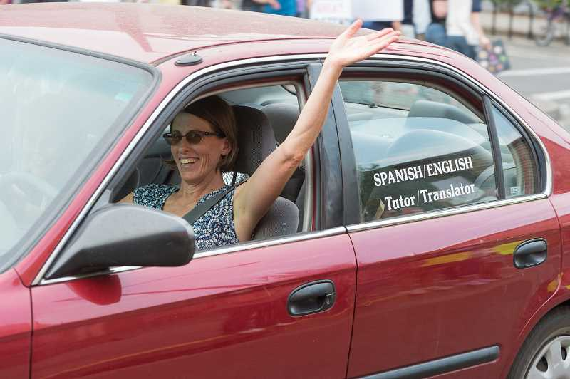 NEWS-TIMES PHOTO: CHRISTOPHER OERTELL - A driver passing by waves her support of the protesters.