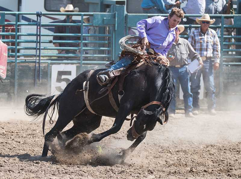 LON AUSTIN/CENTRAL OREGONIAN - Ryan Newman makes a successful ride in the ranch bronc riding event Saturday at the annual Paulina Amateur Rodeo. Newman won the event with a score of 73. Newman also won the bareback riding at the rodeo.