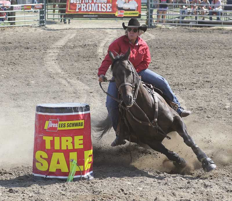 LON AUSTIN/CENTRAL OREGONIAN - Paulina resident Lisa McLean makes her run in barrel racing. McLean won the event with a time of 16.87 seconds.