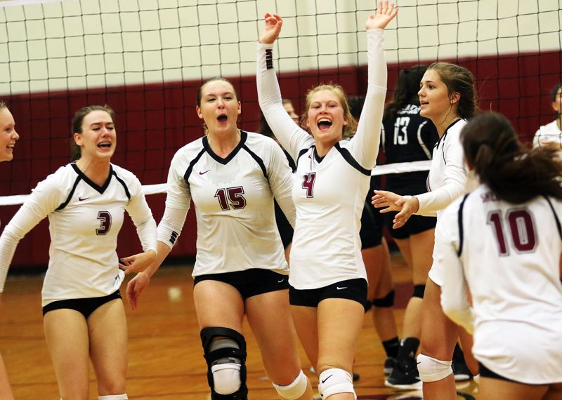 DAN BROOD - The Sherwood volleyball team, inclding senior Emily Bacewich (3), junior Alyssa Haslip (15) and junir Alyssa Dillree (4) celebrates a point during the Bowmen's match with Tigard.