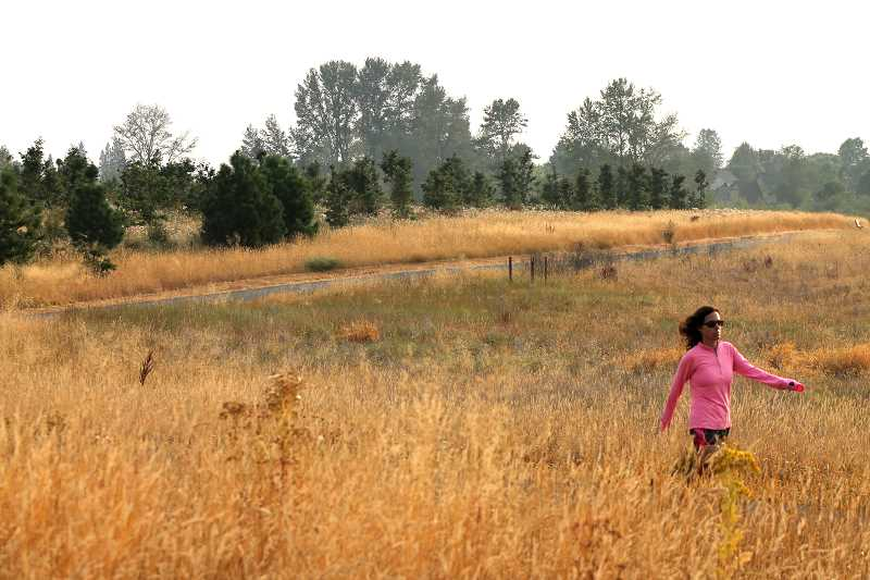 SPOKESMAN PHOTOS: LESLIE PUGMIRE HOLE - The grassy savanna of the park had to be entirely replanted to restore native plants and animals to the park site.