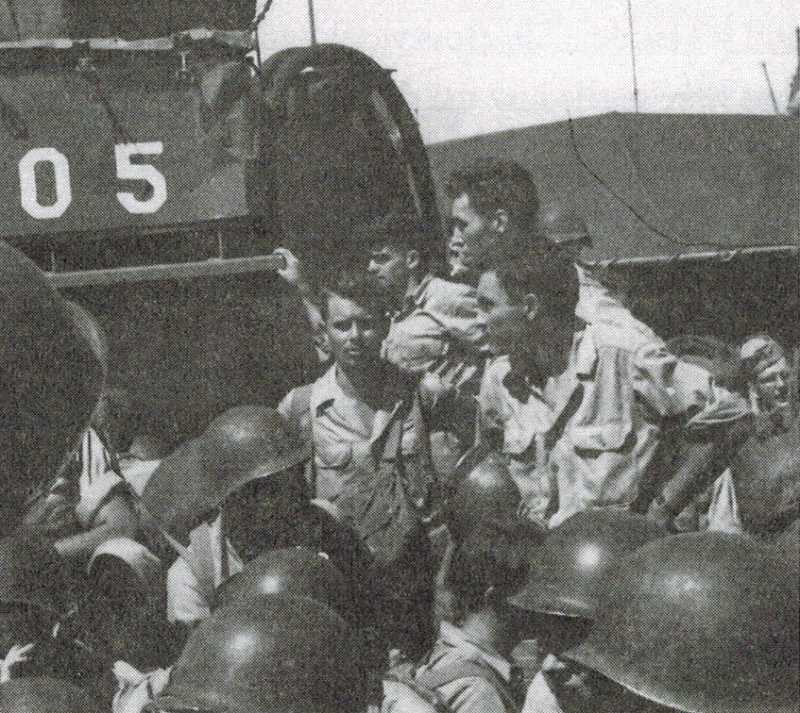 COURTESY OF GRANT VALENTINE - Grant Valentine (center, facing the camera) is part of a landing at Manila in the Philippines in August 1945 just after atomic bombs were dropped on Hiroshima and Nagasaki in Japan.