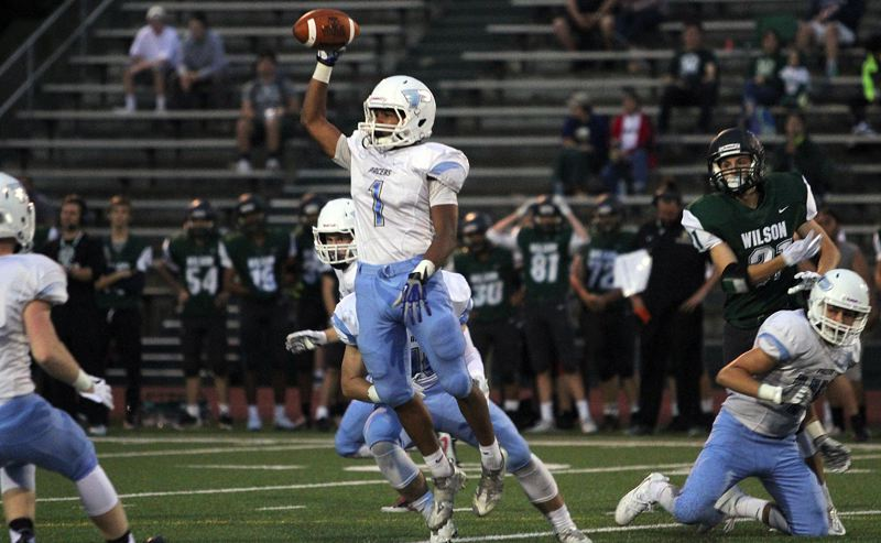 REVIEW PHOTO: MILES VANCE - Lakeridge's Andre Martinez celebrates an interception during his team's 55-0 win over Wilson at Wilson High School on Friday night.