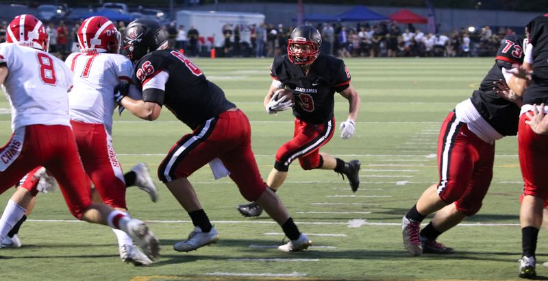 REVIEW PHOTO: JIM BESEDA - Clackamas' James Milspaugh runs to daylight during his team's 45-0 non-league home win over Lincoln on Friday night.