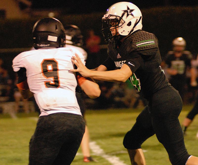 ESTACADA NEWS: MATT RAWLINGS - Estacada's David Stamm throws a block on Scio's Ryan Imel.