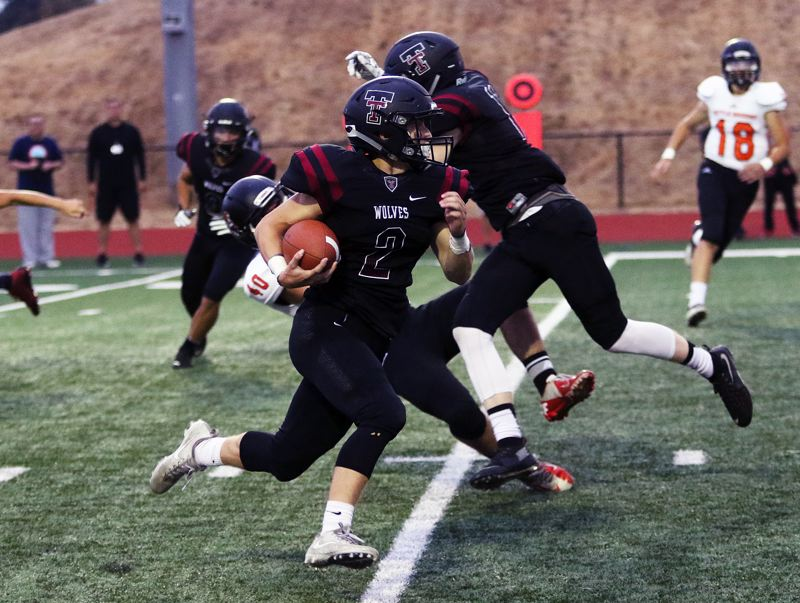 DAN BROOD - For the second straight week, Tualatin junior Jake Anderson returned the opening kickoff for a touchdown. But, unfortunately for the Wolves, this apparent TD was nullified due to a penalty.