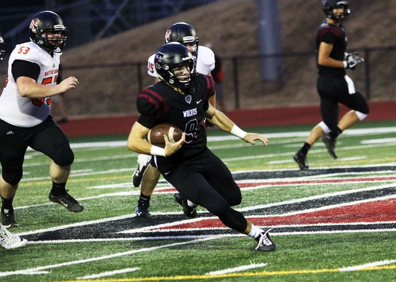 DAN BROOD - Tualatin junior quarterback Kyle Dernedde scrambles for a 41-yard gain during the 53-0 win over Battle Ground.