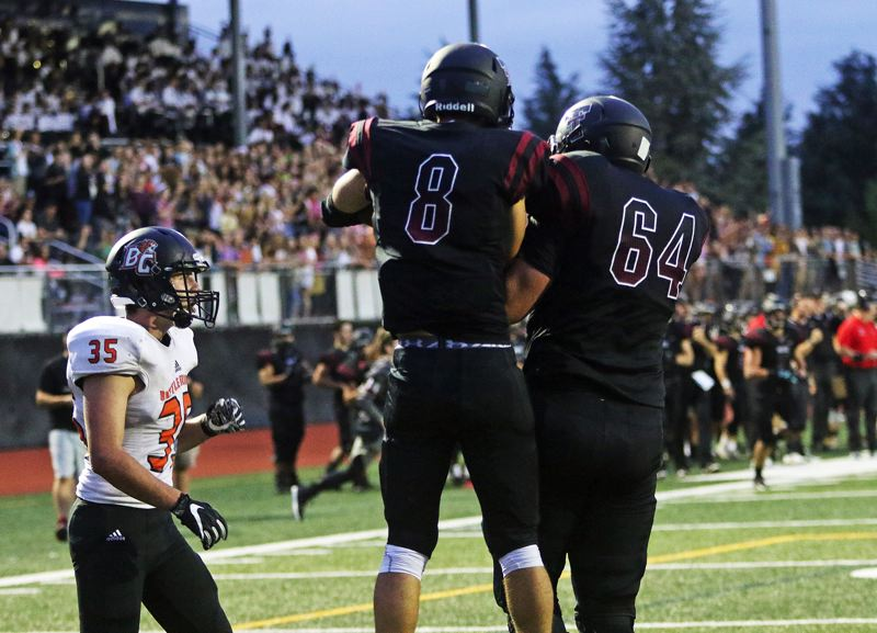 DAN BROOD - Tualatin senior receiver Chris Freese (8) and junior lineman Quinn McCarthy celebrate following Freese's 8-yard touchdown catch.