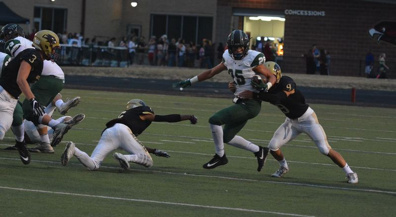 TIMES PHOTO: MATT SINGLEDECKER - Tigard senior wide receiver Braden Lenzy fights off a tackle against Southridge.