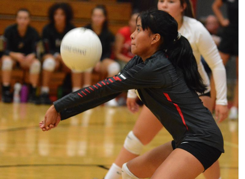 OUTLOOK PHOTO: DAVID BALL - David Douglass Nicole Trujillo-Salazar bumps a ball into the front row during the Scots 25-18, 25-20, 25-20 win over Reynolds on Thursday.