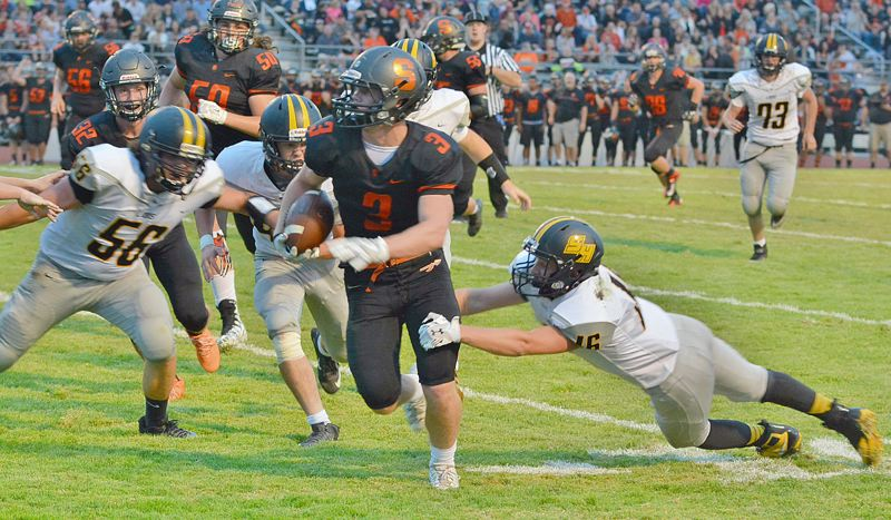 SPOTLIGHT PHOTO: JAKE MCNEAL - Scappoose running back Jimmy Jones heads upfield during his team's 62-6 home win over St. Helens in the annual 'Seven-Mile War' rivalry game on Friday.
