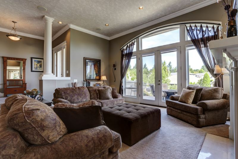 PHOTO COURTESY MICHAEL PATRICK - This living room offers more natural lighting and stunning views.