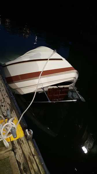 COURTESY PHOTO - The capsized boat was towed into shore from sea.