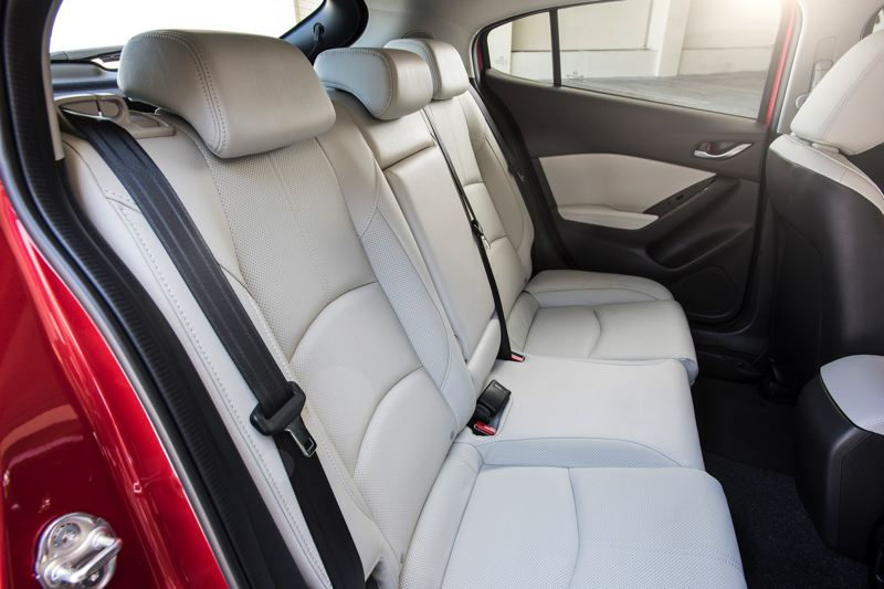MAZDA NORTH AMERICAN OPERATIONS - Rear seat room is good for two adults or three children in the Mazda3.
