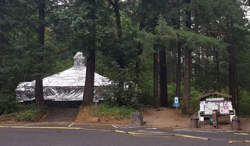 US FOREST SERVICE - Historic shelters at Eagle Creek Campground were wrapped to protect them from burning embers on Saturday.