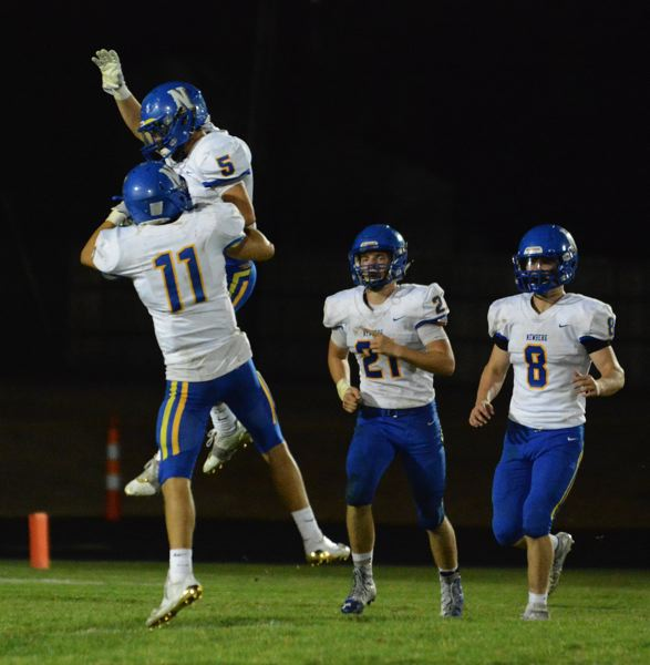 GRAPHIC PHOTO: SETH GORDON - Newberg's Tristan Phillips-Price celebrates after coming up with an interception early in the fourth quarter that would help seal the Tigers' 56-27 victory at Centennial.
