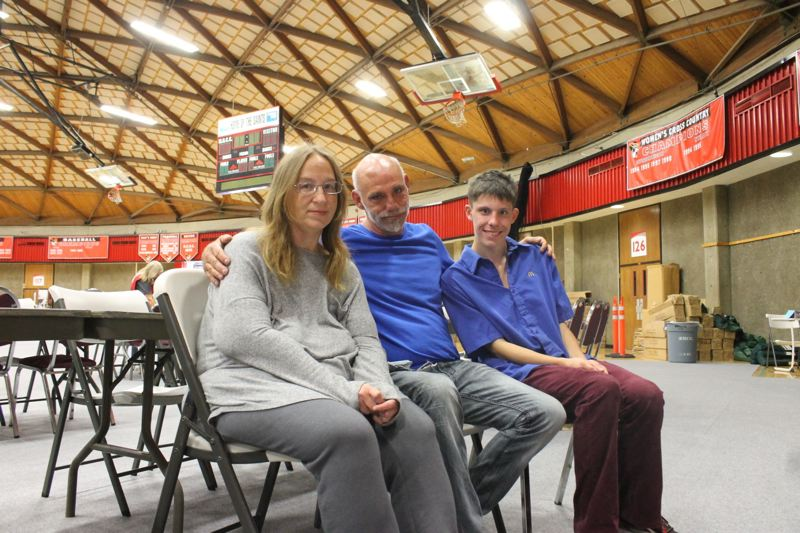 TRIBUNE PHOTO: LYNDSEY HEWITT - About 20-30 people a night have been staying at the Red Cross center set up at Mt. Hood Community College in Gresham. Timothy Stopka, his fiancee Mya, and son Bryson, 19, have been staying there for several days.