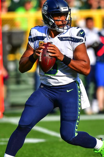 PHOTO BY MICHAEL WORKMAN - Seahawks quarterback Russell Wilson was sacked three times.