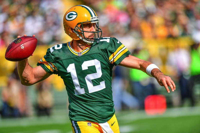 PHOTO BY MICHAEL WORKMAN - Packers quarterback Aaron Rodgers leads a drive at Lambeau Field.