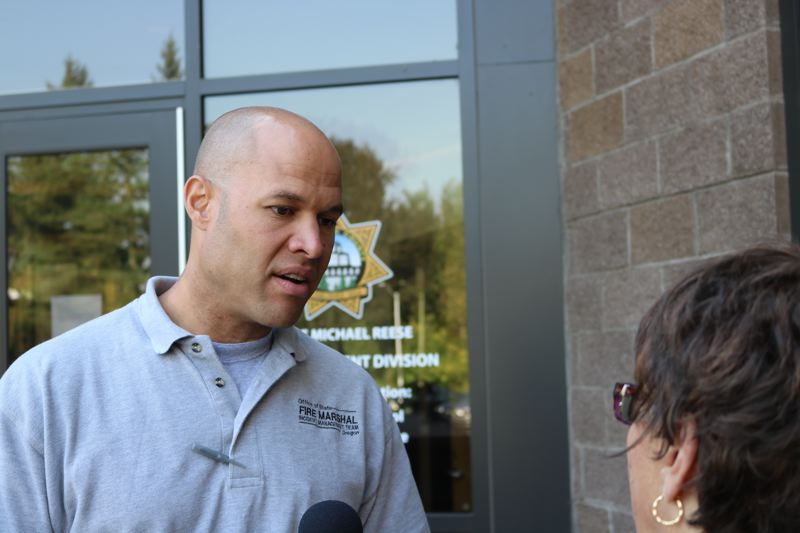 OUTLOOK PHOTO: ZANE SPARLING - Fire spokesman Damon Simmons speaks with reporters on Monday, Sept. 11, in Troutdale.