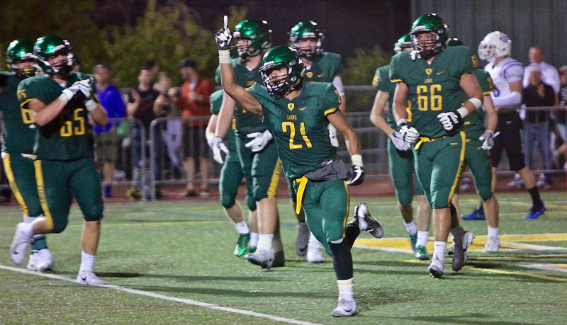 COURTESY PHOTO: FAITH VARGA - West Linn's Qawi Ntsasa celebrates a touchdown — one of his two on the night — during the Lions' 21-14 home win over South Medford on Friday night.