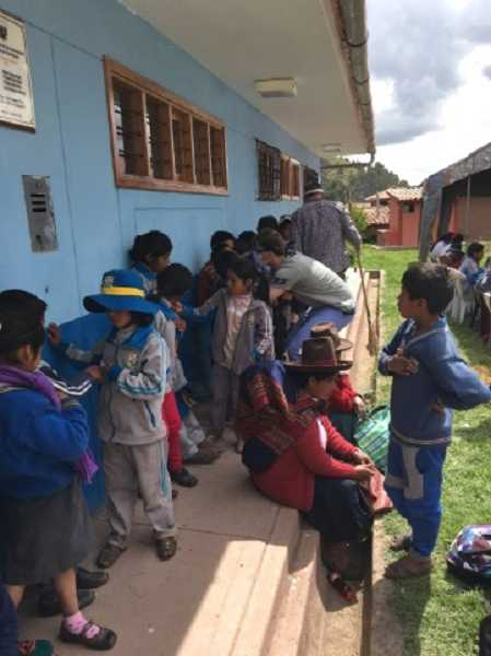 COURTESY OF GREG WILLIAMS - A line of children waits to be seen at the team's first clinic at the medical center in the village of Ocotuán in Peru.