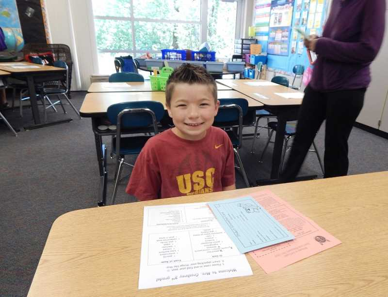 REGAL COURIER PHOTO: BARBARA SHERMAN - David Kurns is all settled at his desk in Brenda Croskrey's third-grade classroom at Deer Creek Elementary on Aug. 31, when students and parents could drop off school supplies, find classrooms and  meet teachers.