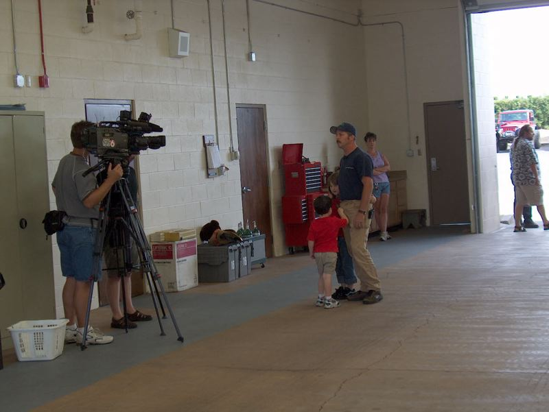 SUBMITTED PHOTO - In 2005, Clackamas firefighter Bob Norton and his daughter Abbie Norton, 6, are interviewed by KOIN 6 News prior to going to help Katrina victims.