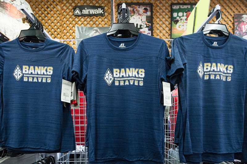 NEWS-TIMES PHOTO: CHRISTOPHER OERTELL - The new Banks Braves logo is now in use. These shirts can be found at Frye's Action Athletics in Forest Grove.