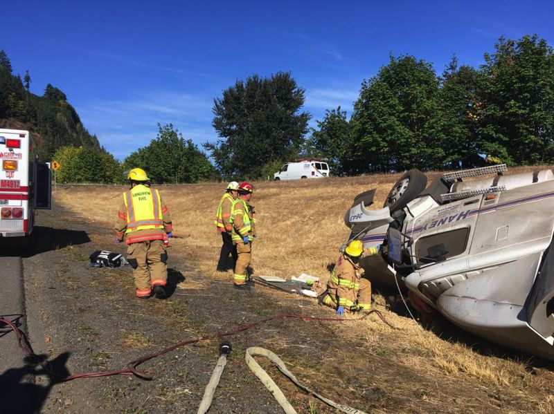 PHOTO COURTESY OF COLUMBIA RIVER FIRE AND RESCUE - Columbia River Fire and Rescue crews responded to a single vehicle rollover crash involving a semi truck, Tuesday, Sept 12.
