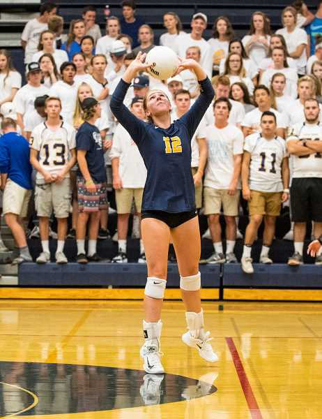 LON AUSTIN/CENTRAL OREGONIAN - Crook County High School setter Anna Woodward sets a ball during the Cowgirls' loss to Bend on Thursday. Woodward finished with seven assists in the match and was six for seven from the service line.