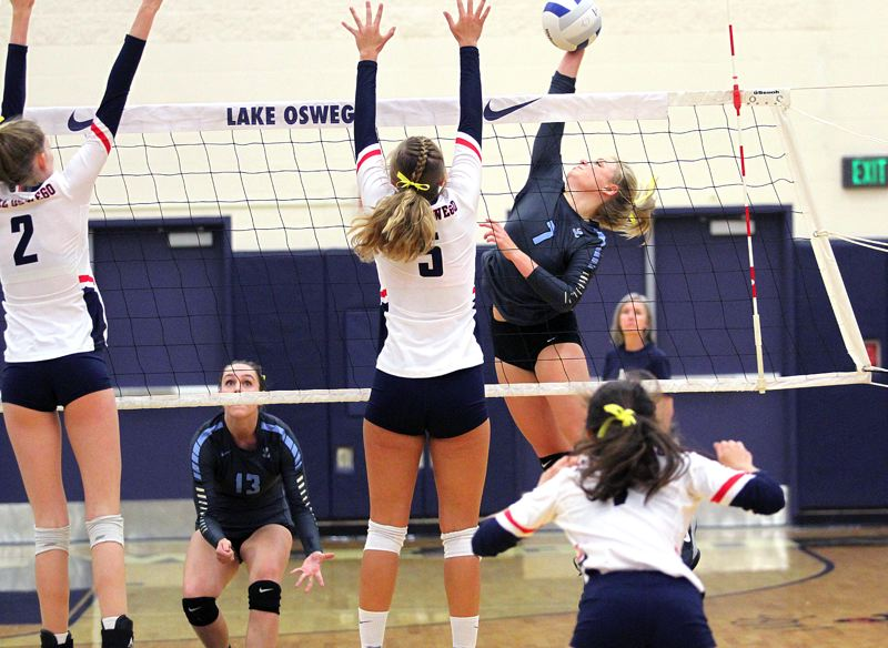 REVIEW PHOTO: MILES VANCE - Lakeridge's Reilly Santa connects for a kill during her team's 3-1 win over Lake Oswego at Lake Oswego High School on Monday.