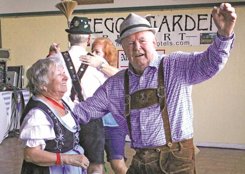 INDEPENDENT FILE PHOTO - Mount Angel's Oktoberfest celebrates Bavarian culture with dancing, music, food and drinks, but also aims to give back to the community. The proceeds from the volunteer-run event support local organizations, schools, civic groups and more.