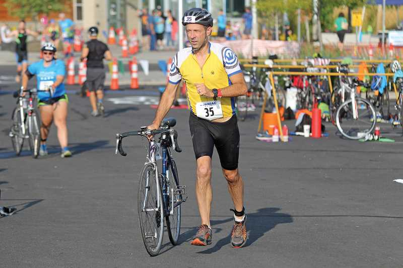 WILL DENNER/MADRAS PIONEER - David Sieveking takes off with his bike to begin the second leg of the MAC Dash Sprint Triathlon Saturday. Sieveking finished 10th among all male competitors in 1 hour, 14 minutes and 31 seconds