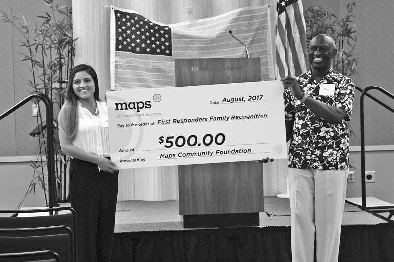 PHIL HAWKINS - Maps Credit Union donated $500 to the First Responders Family Recognition in the hopes of making it an annual event. The gift was presented by Christa Brustad to Ari Archibald (left) and Ewart Brown (right), members of the event's planning committee.