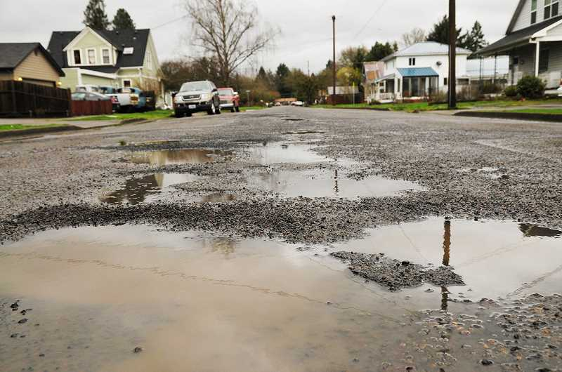 GRAPHIC FILE PHOTO - The city public works department has asked the Newberg City Council for an additional $200,000 in funds to buy additional asphalt sealant to complete a $850,000 street maintenance project.