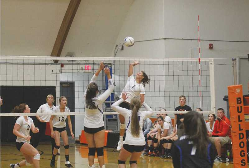 WILL DENNER/MADRAS PIONEER - Playing in her first home game of the season, Culver outside hitter Irma Retano (1) led the Bulldogs with 11 kills in a 3-0 win Thursday against Madras. Freshman Claire Bender (12) added eight kills for Culver.