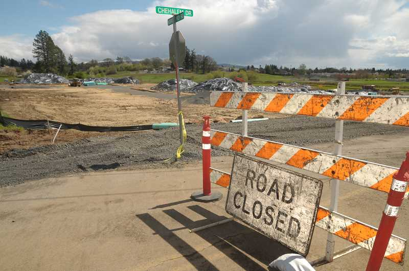 GRAPHIC FILE PHOTO - Work began last summer on two housing developments near the corner of North Valley Road and Chehalem Drive.