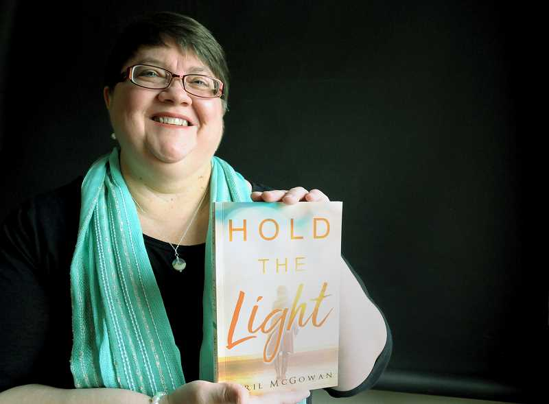 "GARY ALLEN - Newberg writer April McGowan will read from and sign copies of her new novel, titled ""Hold the Light,"" later this month."
