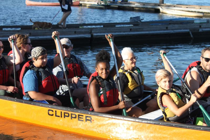 PAMPLIN MEDIA GROUP: LYNDSEY HEWITT - RaNasia Duckett, 12, middle, joins a canoe trip along the Willamette River. She participates in Big Brothers Big Sisters Columbia Northwest with her Big, Deborah Eckel, seated next to her.