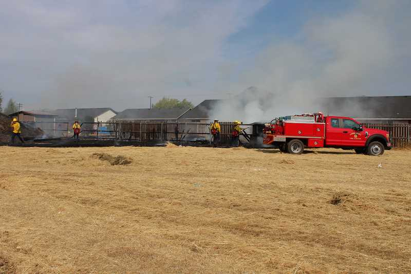 HOLLY SCHOLZ/CENTRAL OREGONIAN - A brush fire came to within 10 or 15 feet of three houses Tuesday afternoon in northeast Prineville.