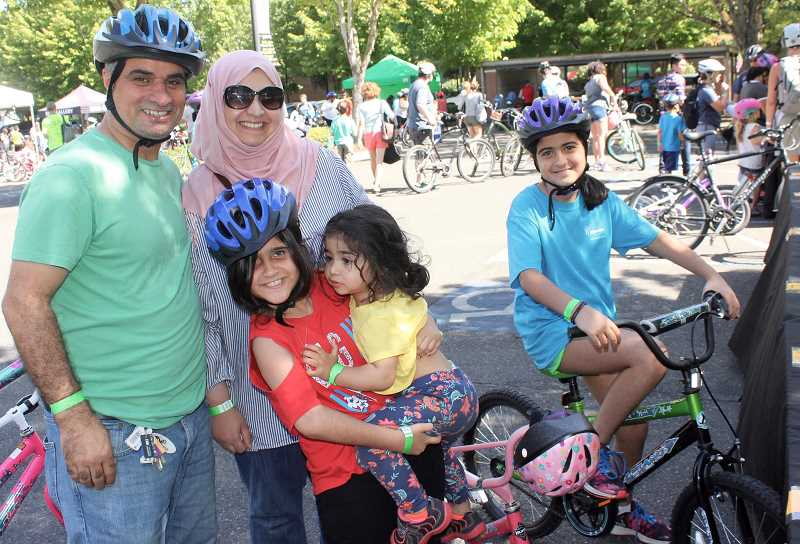 THE TIMES: MANDY FEDER-SAWYER - From left: Fadhel, Hadeel, Jood, Sarah and Farah Aljubouri enjoy the annual Bike Beaverton event at City Park on Sunday, Sept. 10.