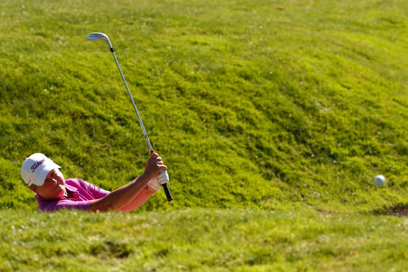 COPYRIGHT USGA/STEVEN GIBBONS - Canadian Golf Hall of Famer Mary Ann Hayward escapes from a bunker Tuesday at Waverley Country Club.
