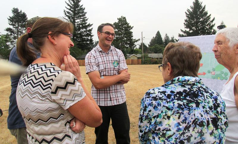 OUTLOOK PHOTO: TERESA CARSON - Portland Parks & Recreation project manager for Lynchview Park, Gary Datka, chats with neighbors about possiblities for Lynchview Park.