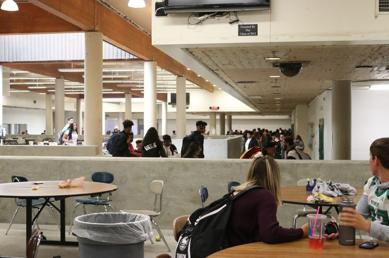 OUTLOOK PHOTO: JOSH KULLA - The busy commons at Reynolds High School is not finished, but students can still eat lunch and gather there to study or catch up with friends.